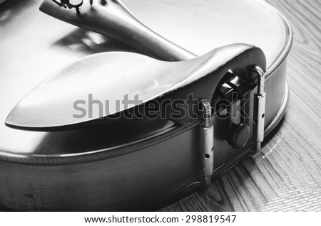 "string instrument ""violin"" on wood background black and white color tone style"