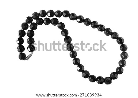 String of black agate beads on white background