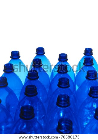 string of blue plastic bottles on white background
