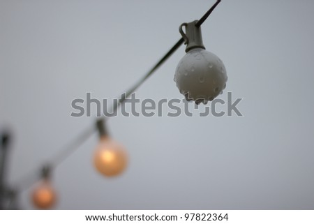 String of Lights with Burnt out Bulb - stock photo