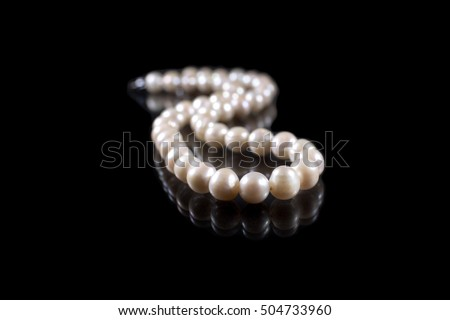 String of pearls on black background