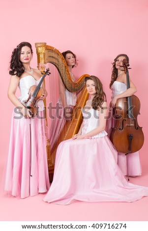 string quartet with harp, cello and violins - stock photo