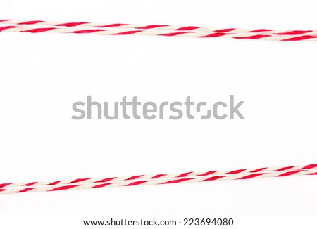 String red and white as frame on white  - stock photo