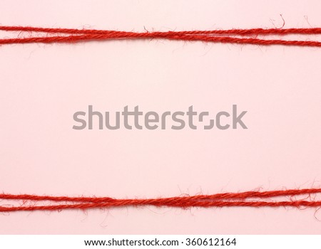 String red as frame on pink background  - stock photo