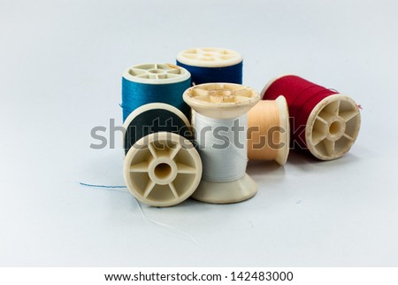 string spools isolated on white - stock photo
