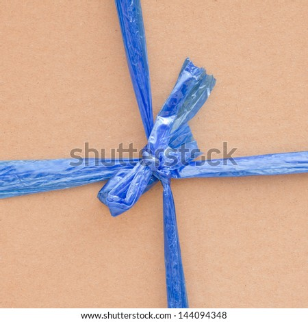 String tied  on a brown recycled paper - stock photo