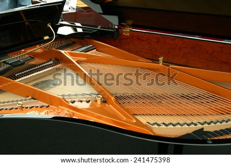 Strings inside the black piano - stock photo