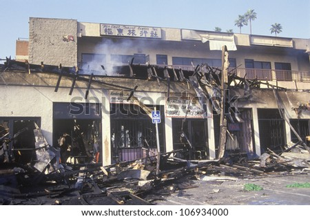 Strip mall burned out during 1992 riots, South Central Los Angeles, California - stock photo