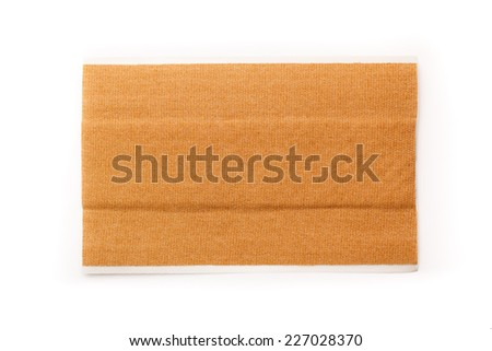 Strip of band aid isolated on a white background. Cure, care, relief. - stock photo