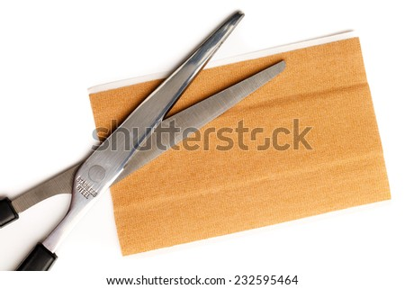 Strip of band aid with scissors  isolated on a white background. Cure, care, relief. - stock photo