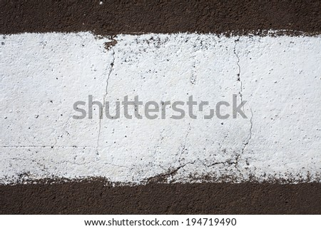 strip of white paint on the pavement. Use as frame or background