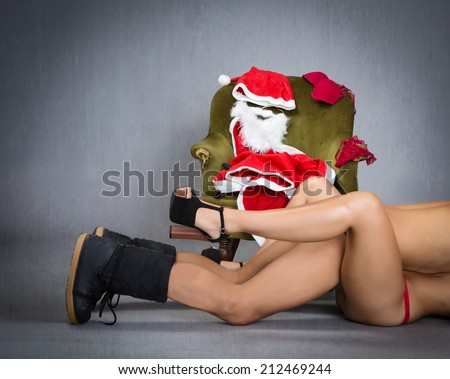 strip tease and hot moment for Santa Claus  - stock photo