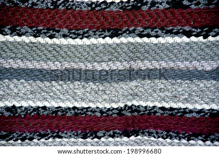Strip woven red and gray rug surface close up. Baltic handmade craft. - stock photo
