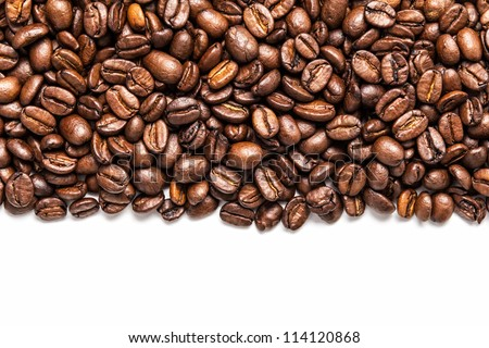 stripe of coffee beans isolated on white - stock photo