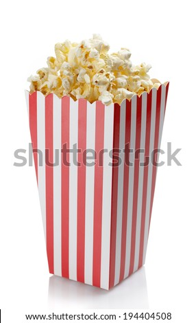Striped box of fresh popcorn isolated on white background - stock photo
