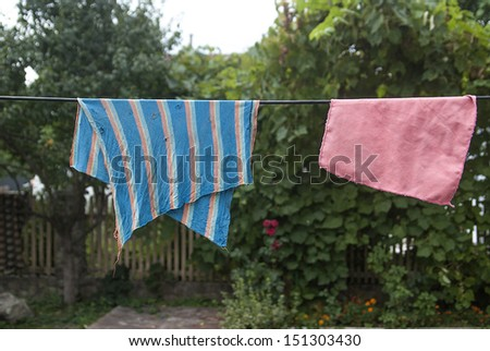 Striped colored rags on a rope