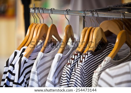 Striped Female Pullovers in a Clothing Store. CloseUp shot with small GRIP - stock photo