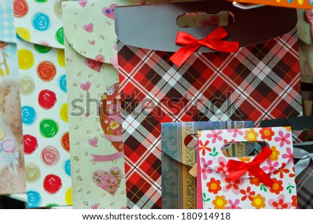 Striped gift bag in the market - stock photo