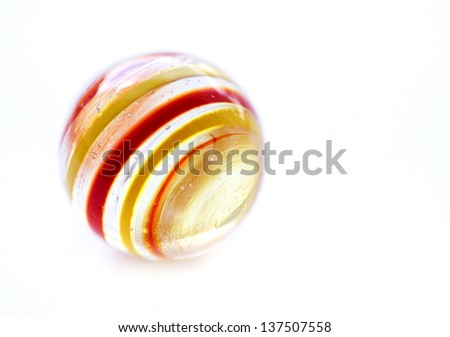 Striped glass marble on white - stock photo