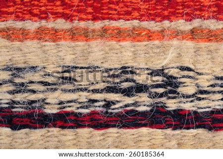 Striped hand woven fabric for background - stock photo