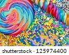 Striped lollipop and multicolored candies - stock photo