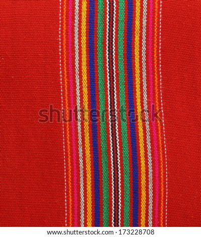striped pattern on red textile fabric  - stock photo