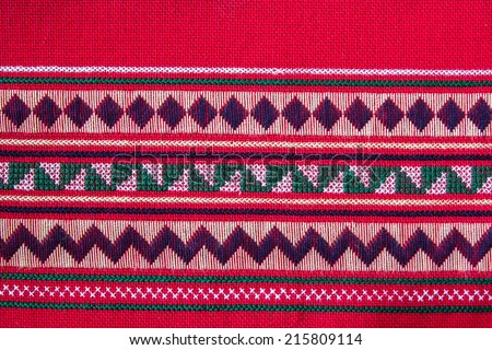 striped pattern on red textile fabric background