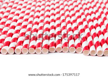 Striped red paper straws on the white background