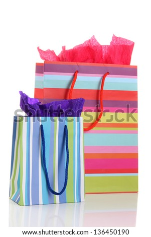 Striped shopping bags isolated on white - stock photo