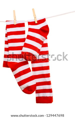 striped socks hanging on a rope - stock photo