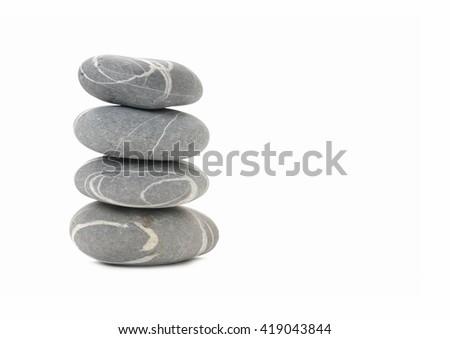 striped stones isolated on white background - stock photo