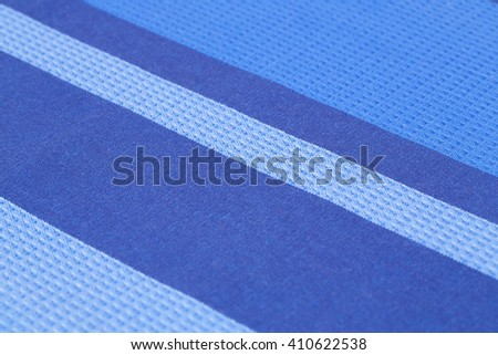 Striped tablecloth texture as a background, closeup picture. - stock photo