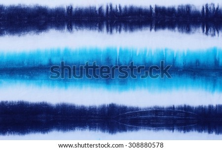 striped tie dyed pattern on cotton fabric abstract background.  - stock photo