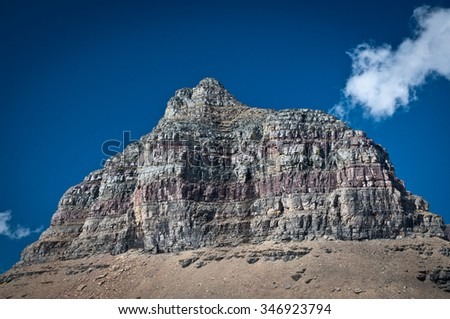 Striped top of a mountain at Glacier National Park - stock photo