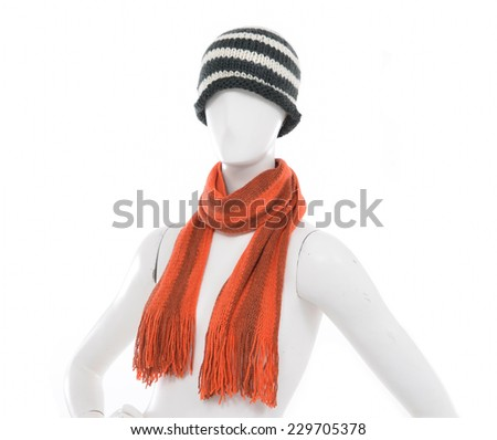 Striped Wool Hat with scarf on female mannequin  - stock photo