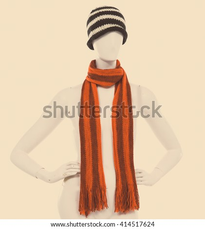 Striped Wool Hat with scarf on female mannequin- retro background - stock photo