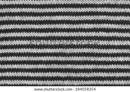 Striped woolen knitted fabric as background. - stock photo