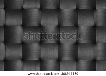 Stripes of scratched black leather weave pattern abstract squares background. - stock photo