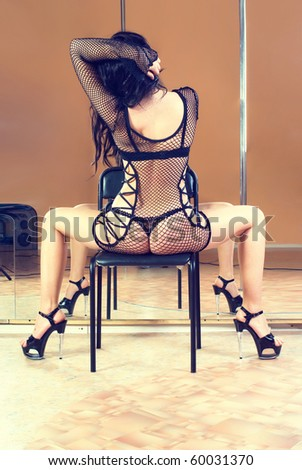 Stripper on chair - stock photo