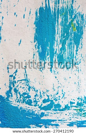strips blue paint on paper, macro