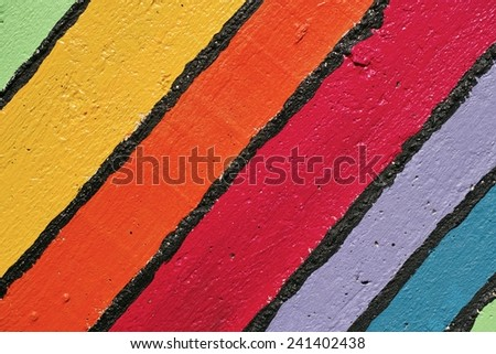strips of several colors on a wall - stock photo