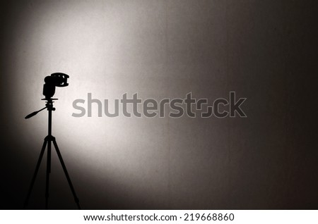 strobe silhouette on a background of gray wall