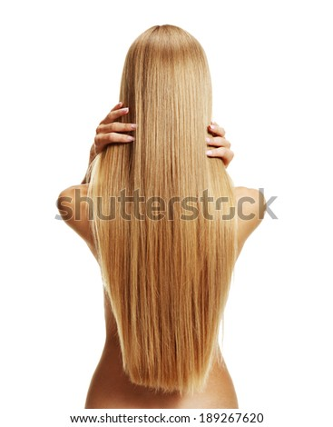 Stroking hair / studio photography of young girl with healthy long hair - isolated on white background