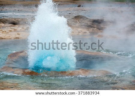 Strokkur geyser blowing high, Iceland in June