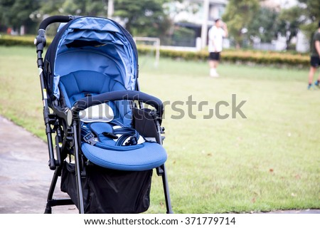 stroller carriage for baby in the garden - stock photo