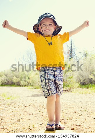 Strong and confident little Boy full length - stock photo