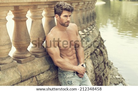 Strong and confident man posing outdoor - stock photo