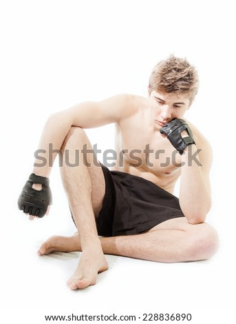 strong and handsome young fighter - stock photo