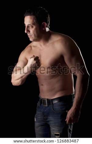 strong and harebrained strong man on dark background
