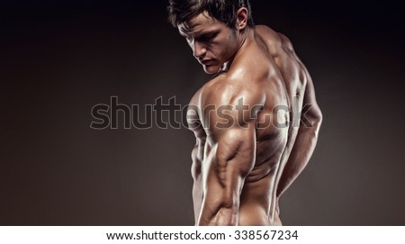 Strong Athletic Man Fitness Model posing back muscles, triceps, latissimus, copyspace - stock photo